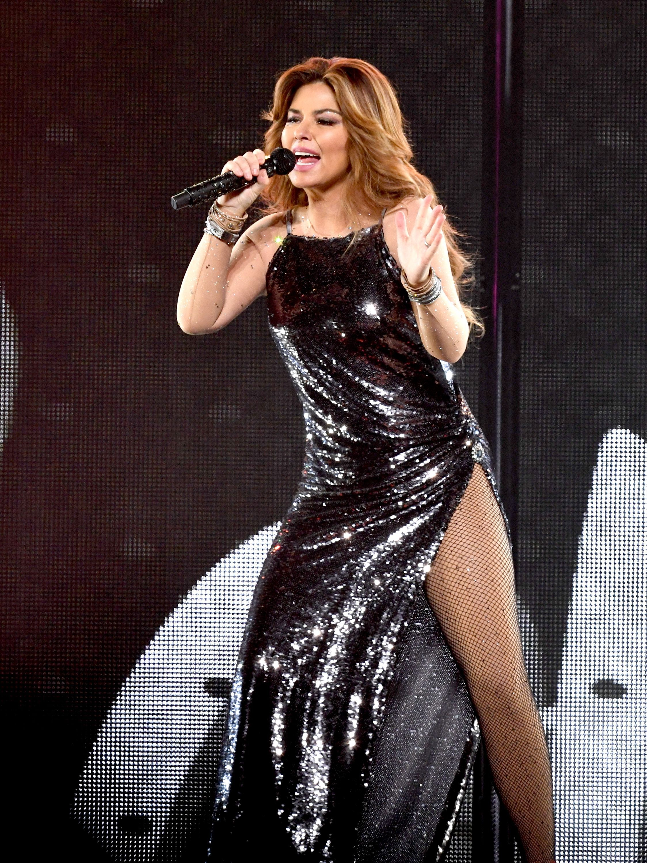 Country star Shania Twain is rocking it out on stage in a