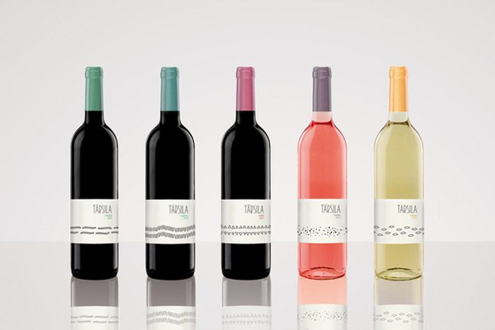 TársilaWine      A redesign for Bodegas Társila to unify its brand image.                  Designed by Raquel Rodilla