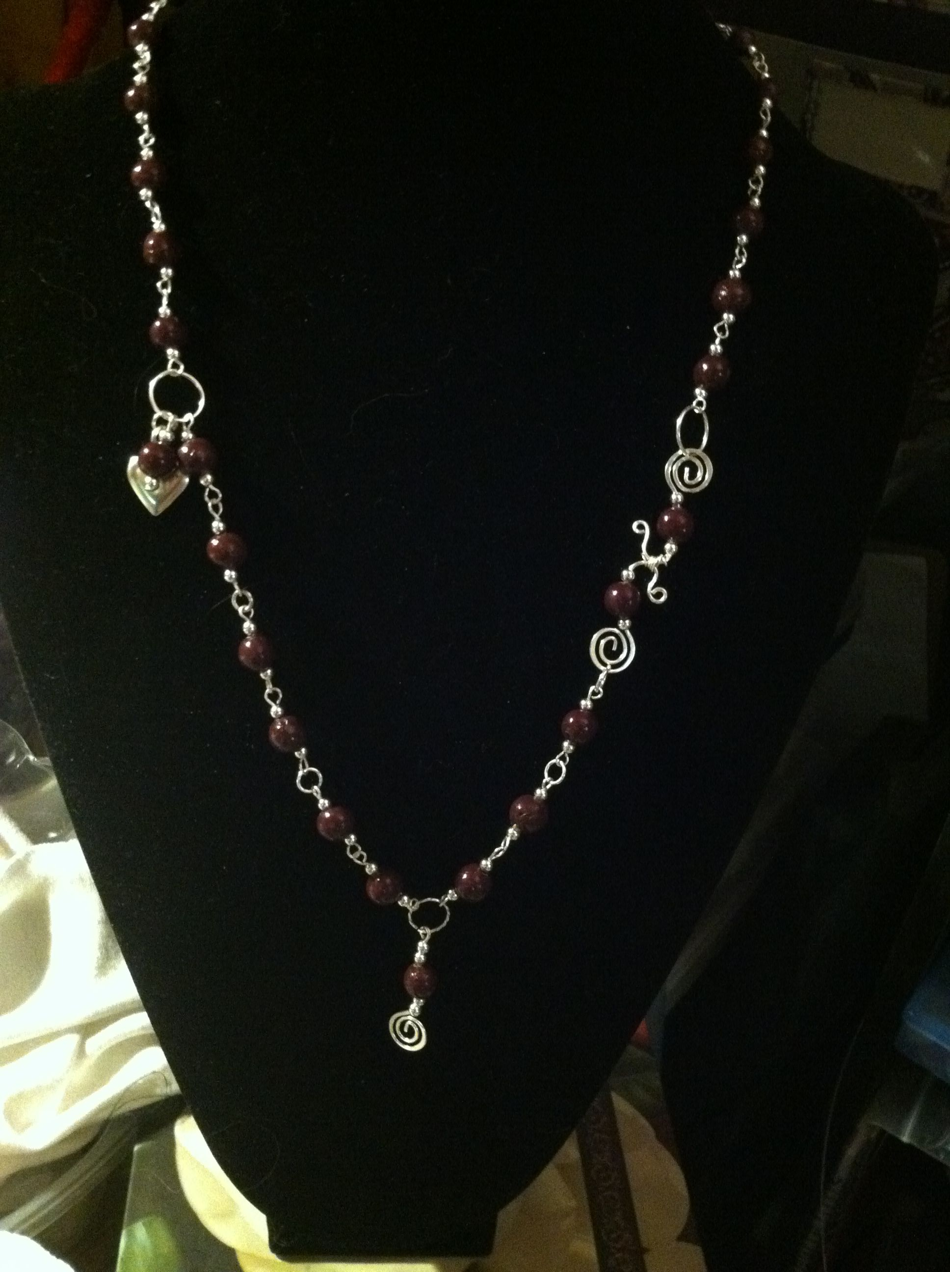 Handcrafted necklace - beads are made from a dried purple rose.