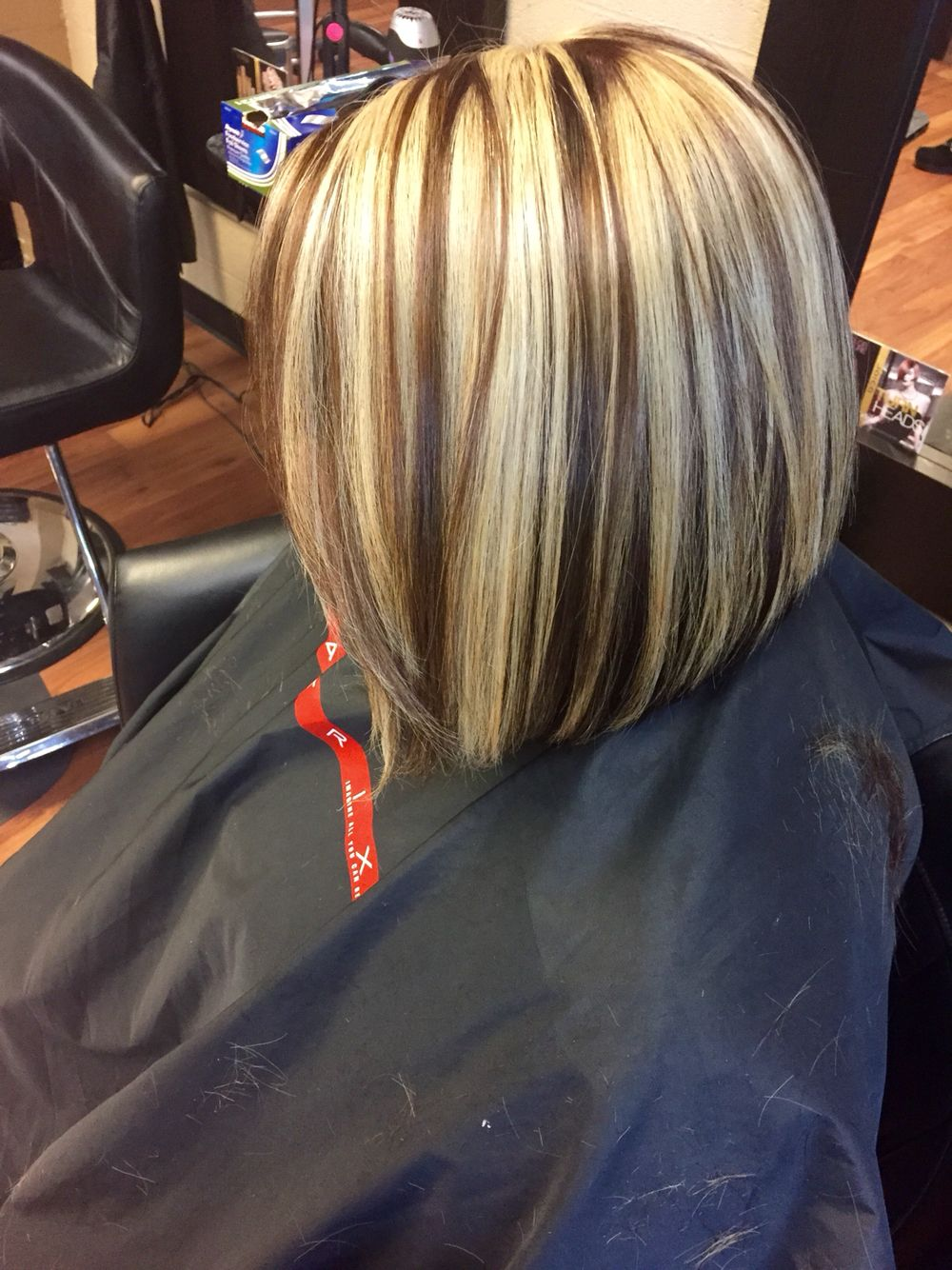 Chunky blonde highlight with a mocha brown base and short hair bob