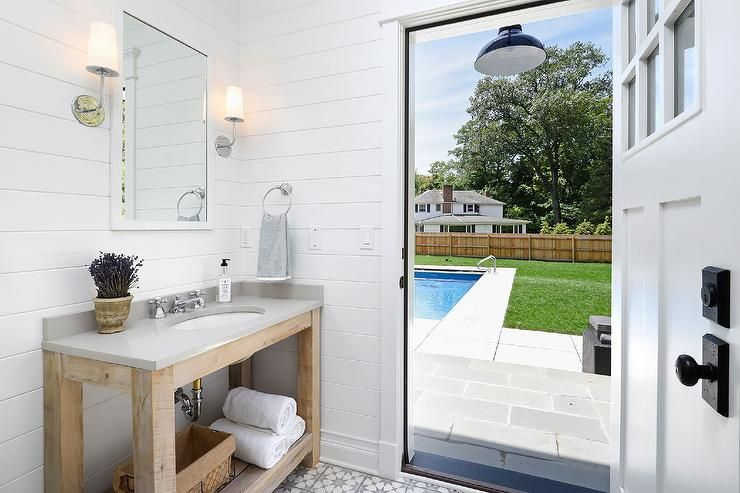 Pool House Bathroom Boasts Shiplap Clad Walls Lined With Reclaimed Wood Vanity Fitted With A Shelf Pool House Bathroom Small Pool Houses Cottage Bathroom