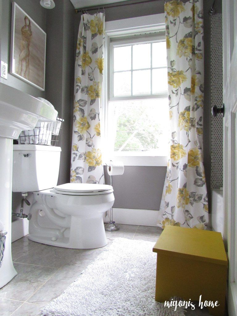 really cute gray and yellow bathroom with vintage style floral curtains decorating. Black Bedroom Furniture Sets. Home Design Ideas