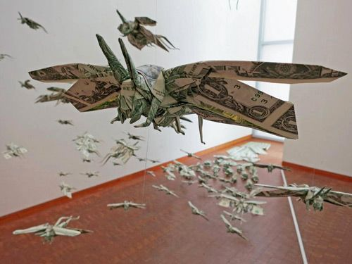 Origami artist Sipho Mabona folded a swarms of dollar bill locusts for the Japanese American National Museum in Los Angeles.