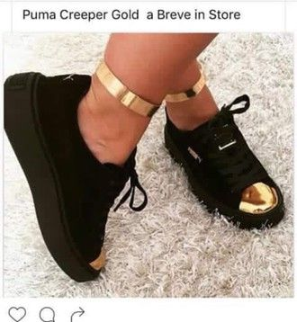 black puma shoes with gold