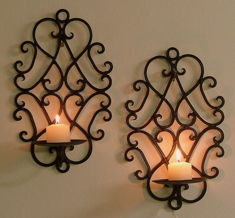 pair of wrought iron candle holders rustic wall