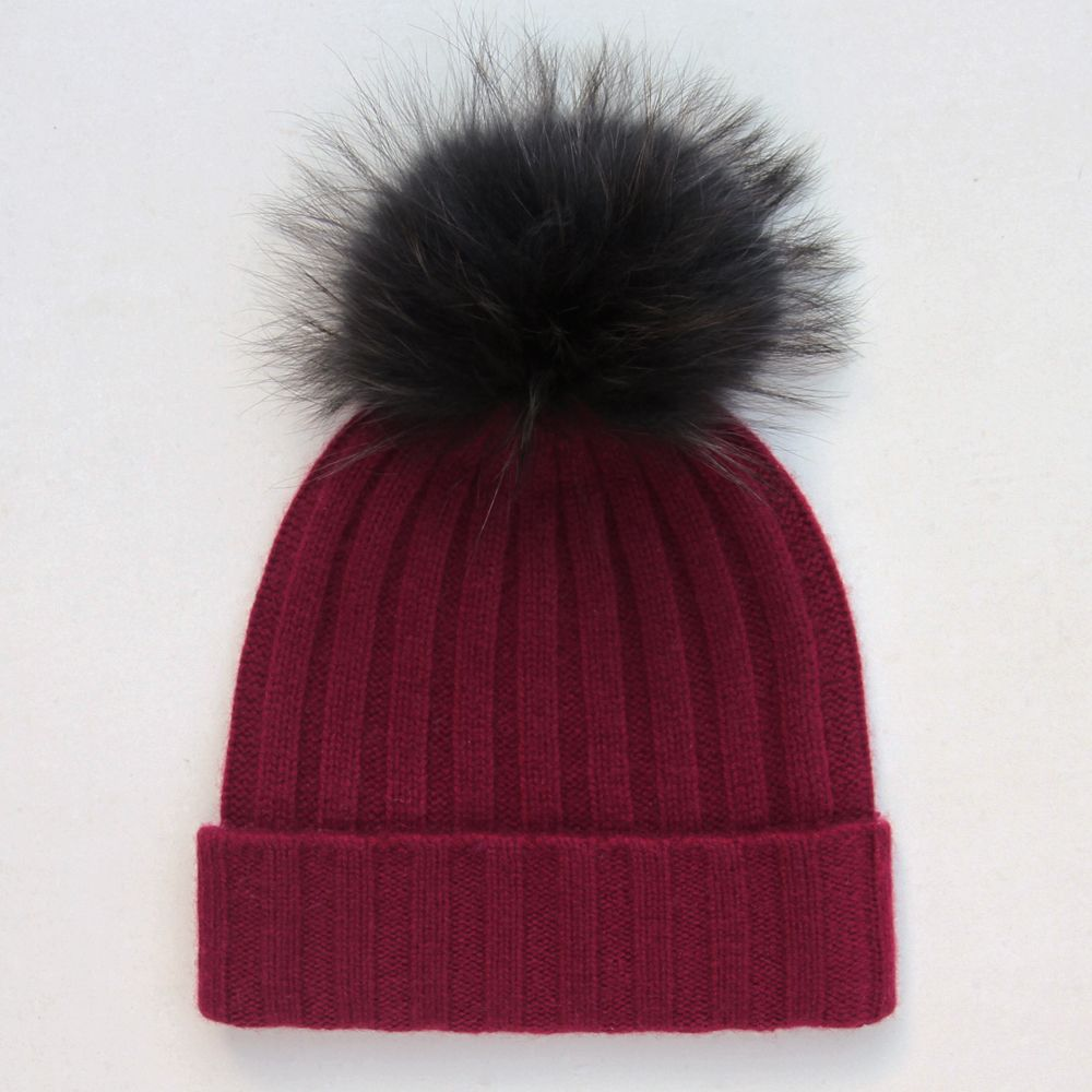 Luxurious and warm this fluffy pom pom cashmere bobble hat is perfect for  the autumn and winter months. Knitted from 100% cosy cashmere in burgundy  and ... e50f4ecd601