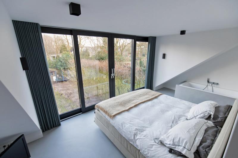 Design woonbeton betondesign gietvloer slaapkamer functioneel