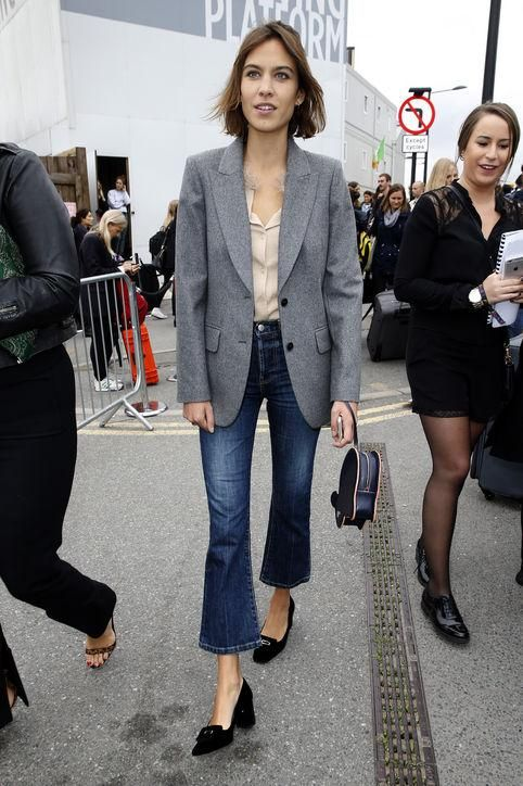 Let Alexa Chung show you how to wear this season's biggest denim trend. She's wearing cropped flare jeans just like she would basic skinnies, mixing them with a simple blouse, a classic blazer, and flats.