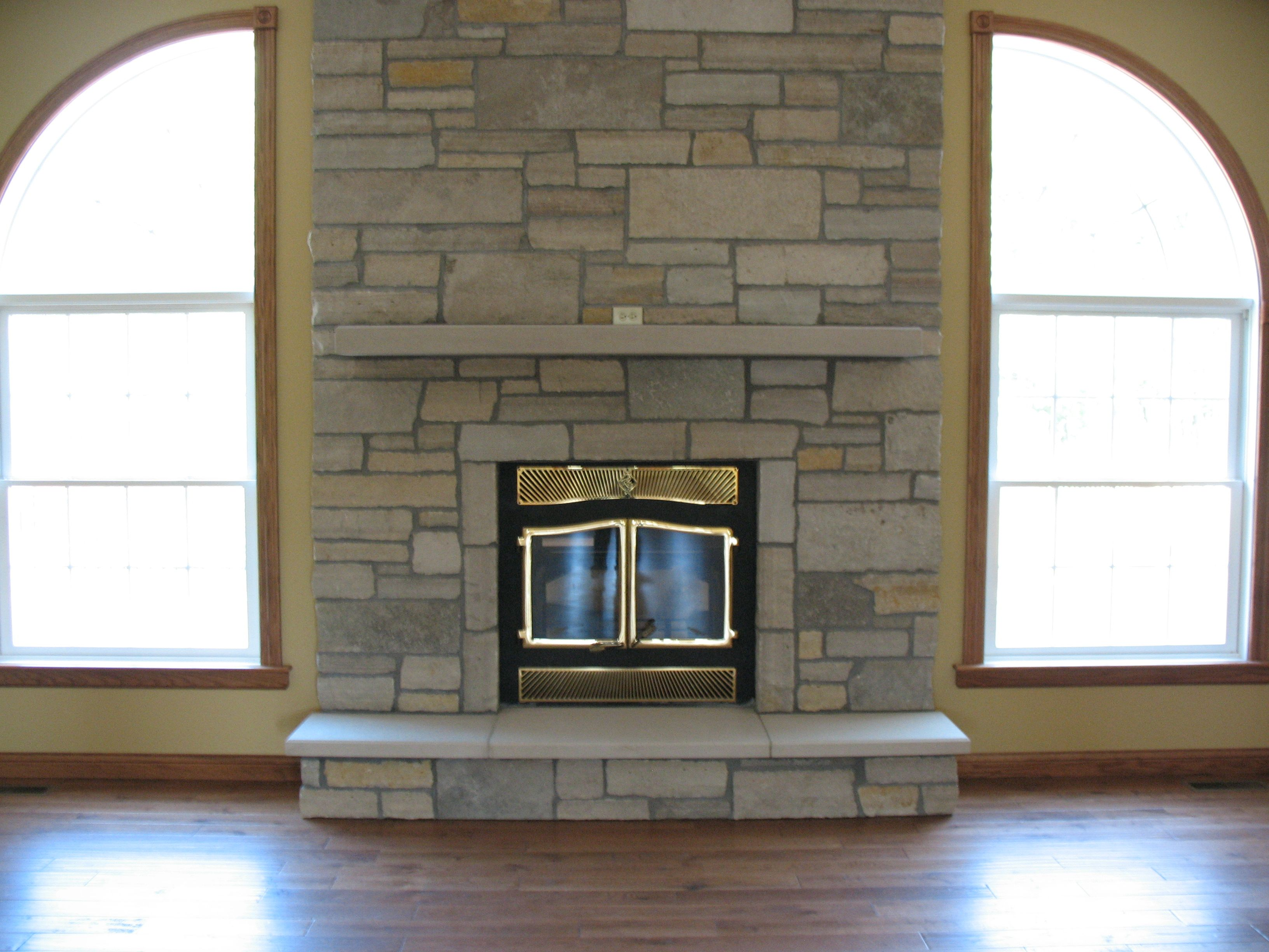 How build stoneveneer fireplace surround Theres something so
