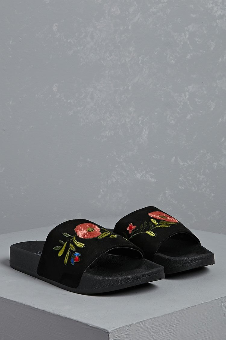 b74c0154184b A pair of faux suede slides by Vintage Havana™ featuring an embroidered  floral upper strap