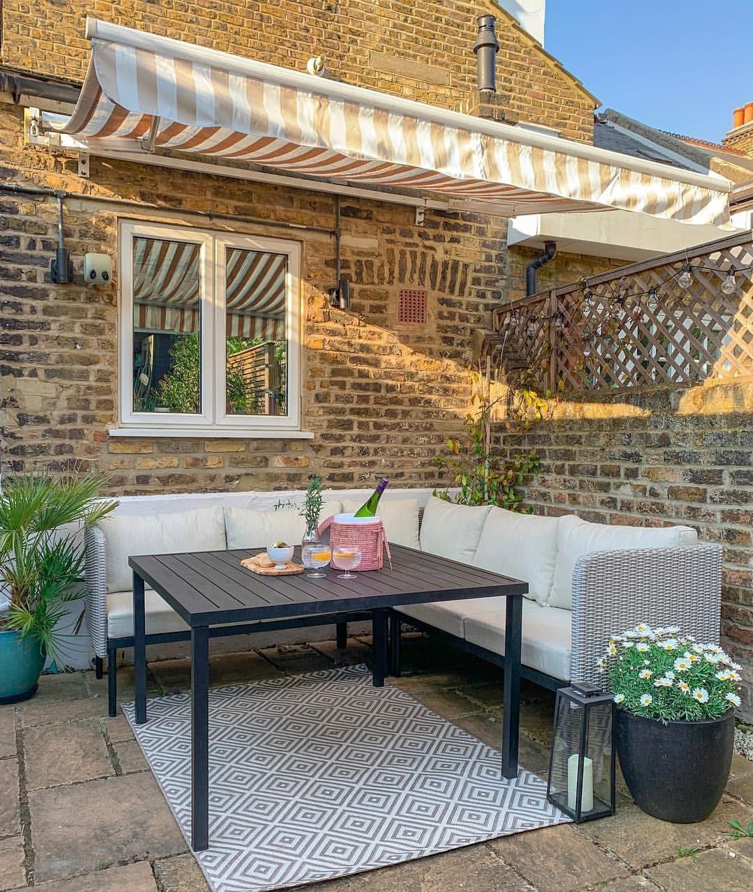 Outdoor garden and patio space. Garden furniture, awning