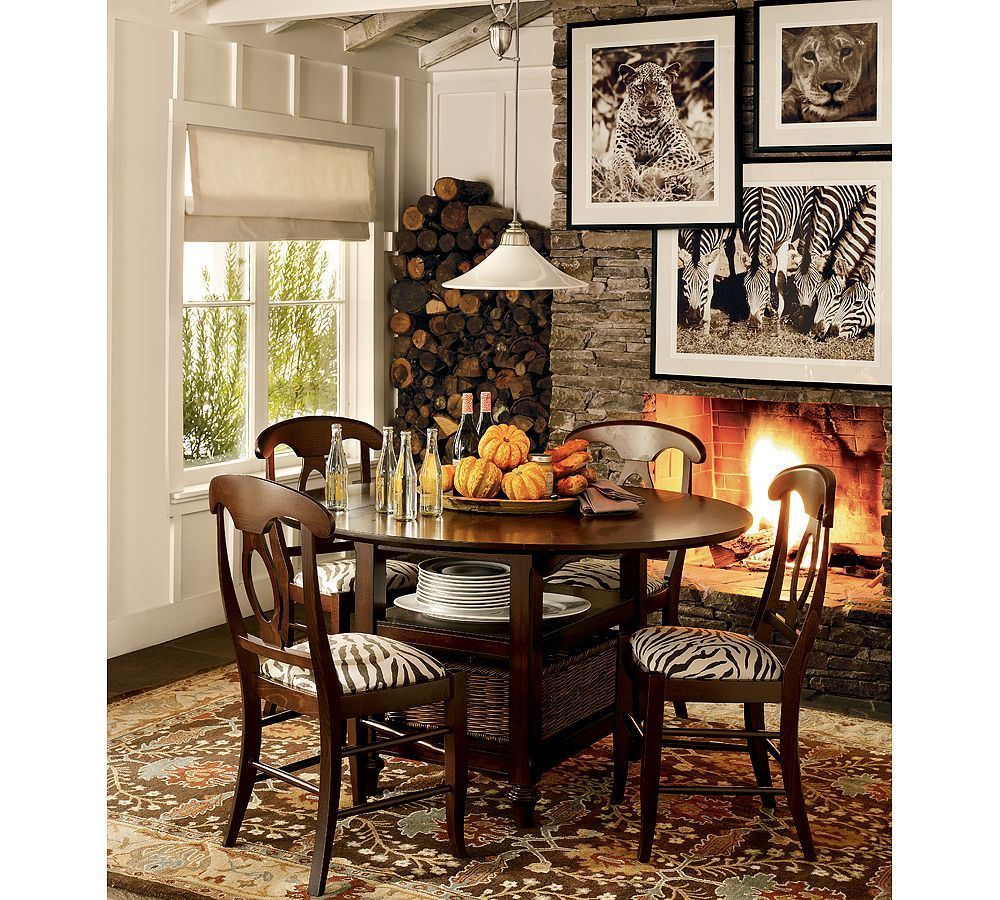 Small table white wall stone fireplace with wild animal prints