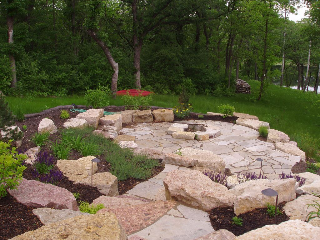 limestone outcropping and flagstone patio and firepit flagstone