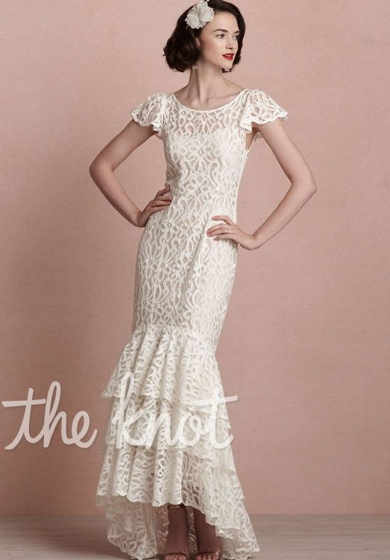 Its kind of different put its really pretty!! :) Gown features lace and asymmetric hem of tiers.