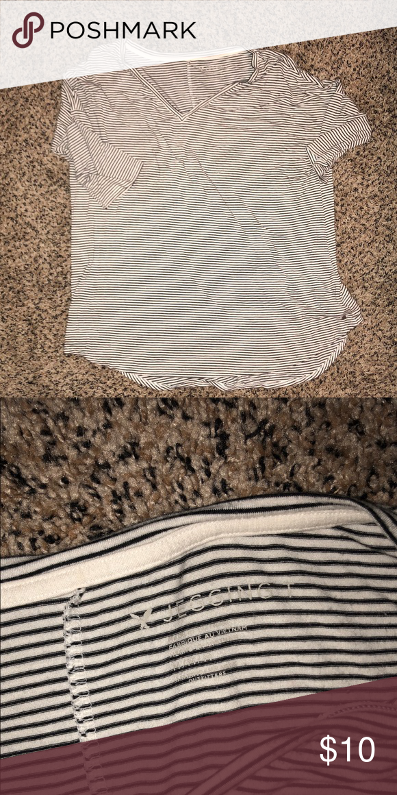 AE Jegging Vneck American Eagle white and black strip shirt! Worn a few times. Still in great shape. Has a looser fit. Never wear anymore! American Eagle Outfitters Tops