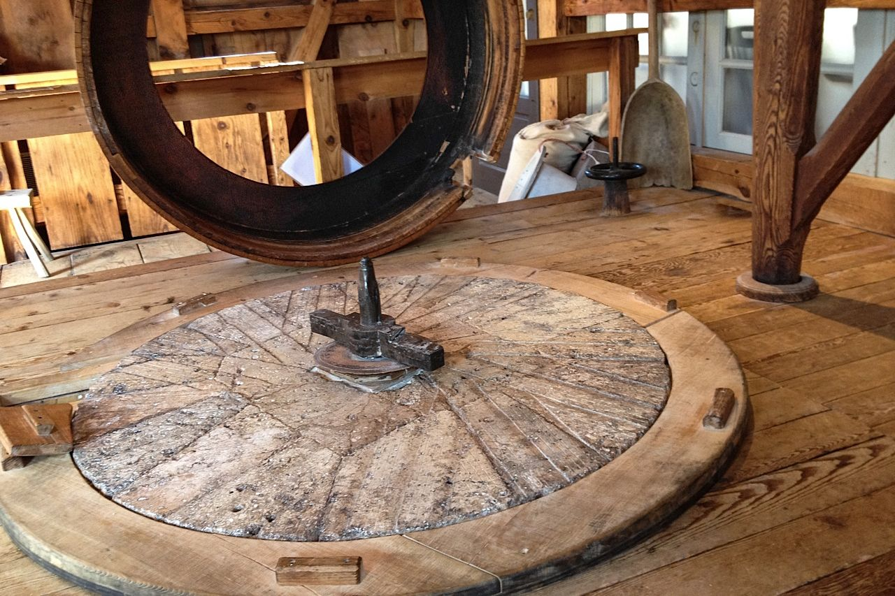 Bottom stone and wooden casing at the Plimoth Grist Mill, which runs on water. Credit: Amy Halloran