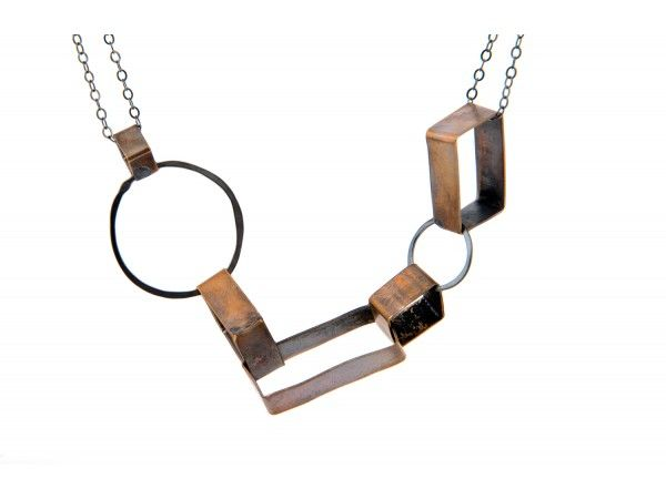 I love this Brass and Silver Oxidized Shapes Necklace from www.OliviadeSoria.com