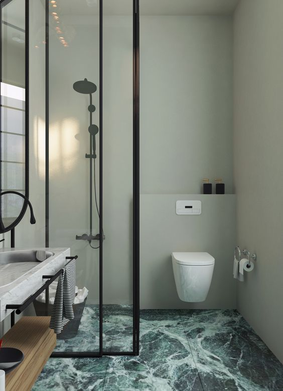 19 Green Marble Tiles Covering The Floor Add Color To The Space