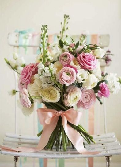 Delightful spring mix of pink and cream flowers