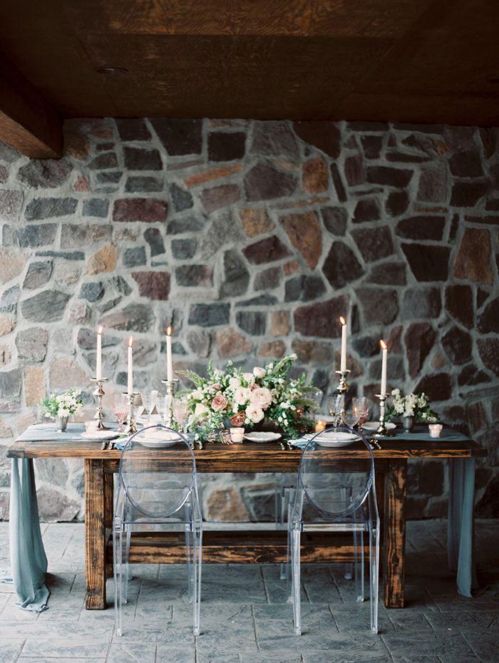 Farm Table Wedding Reception with a River Stone Backdrop  https://heyweddinglady.com/celebrating-rugged-beauty-spring-montana/    #wedding #weddings #weddingideas #styledshoot #weddinginspiration #springwedding #montana #destinationwedding #rusticwedding #weddingreception #eventdesign