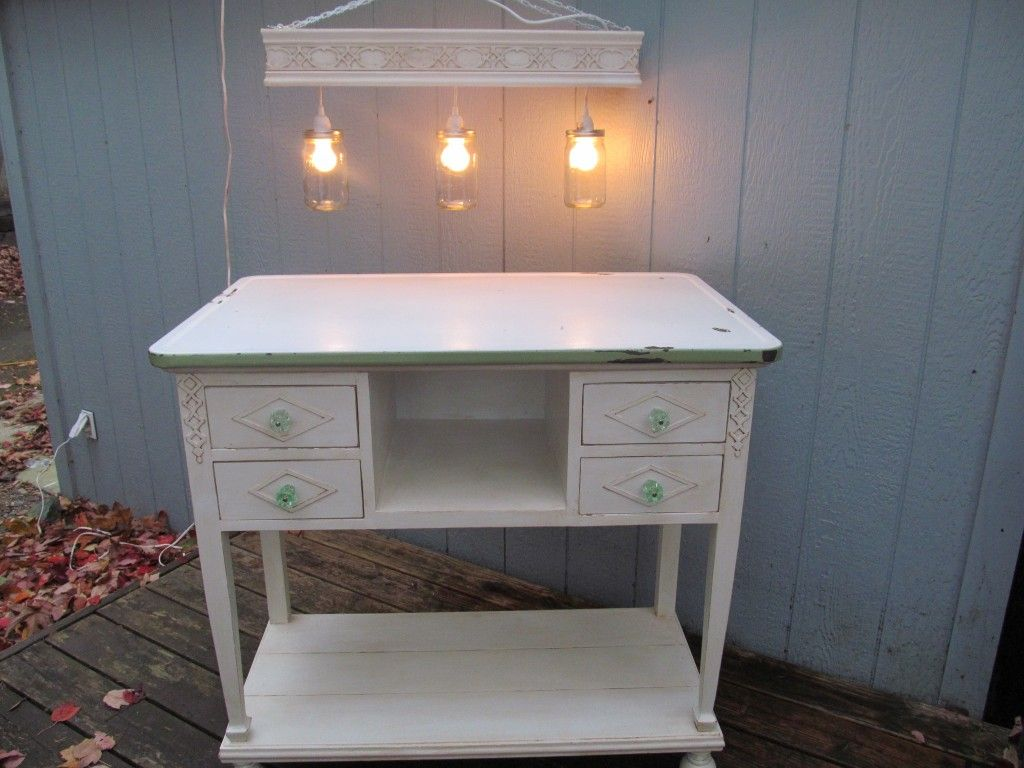 kitchen island repurposed from old side table and vintage enamel