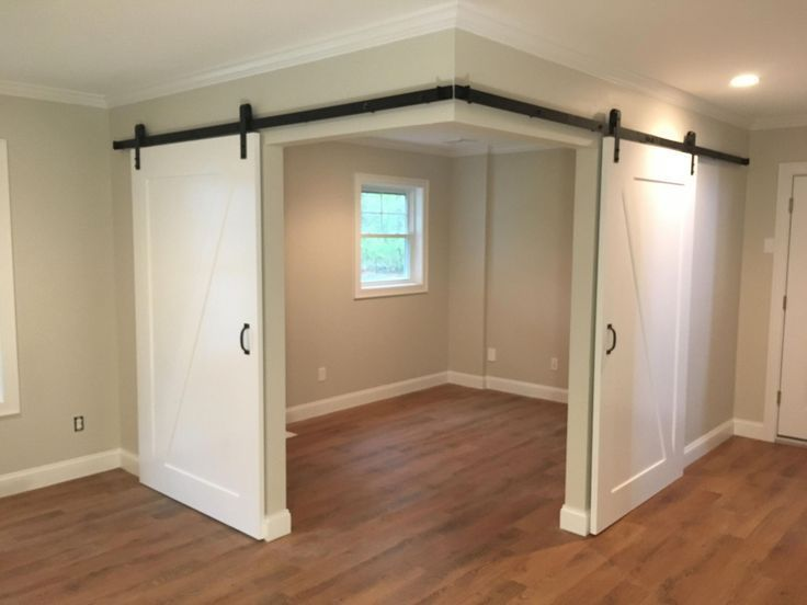 Creates a versatile space in an open space with barn doors Creates a versatile space in an open space with barn doors