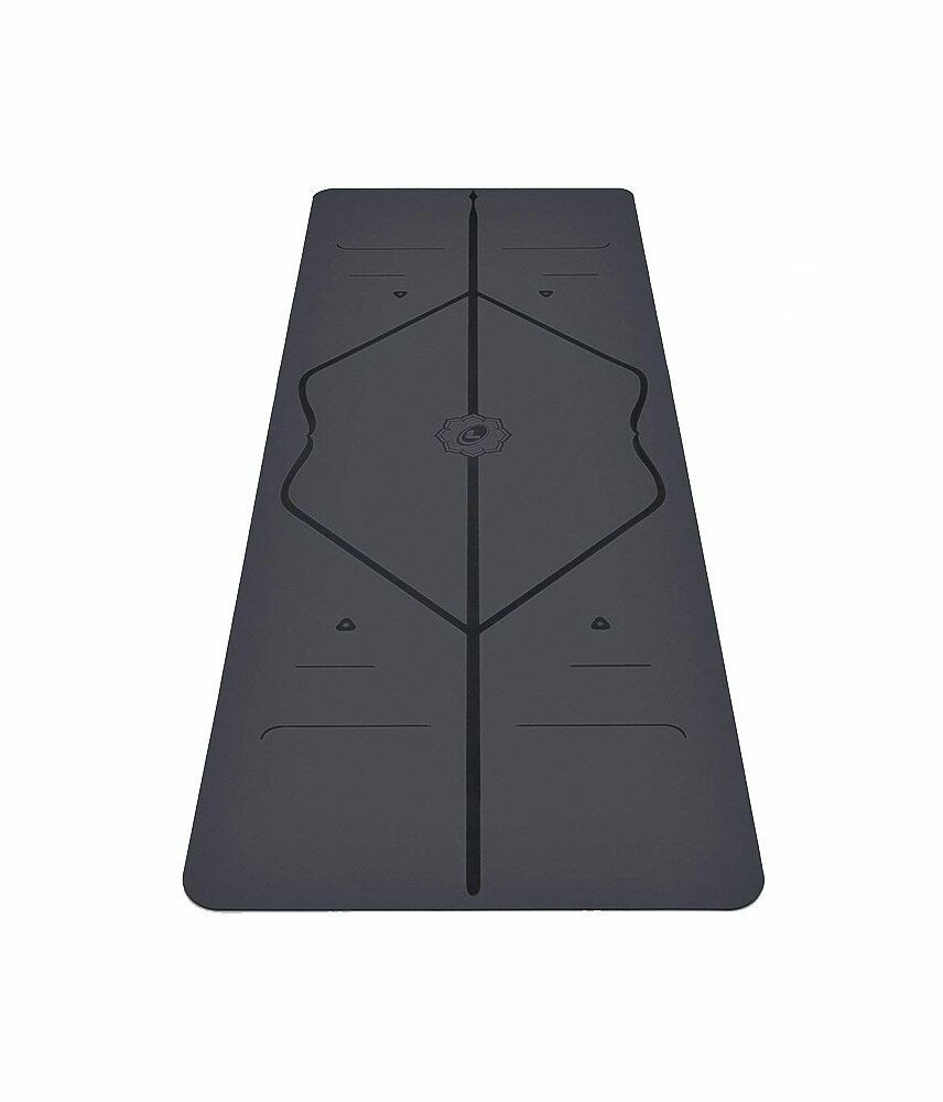 442834f6d7 The 5 Best No-Slip Yoga Mats for Even the Sweatiest Hot Yoga Sessions |  This alignment mat comes with extra supportive cushioning for your knees.