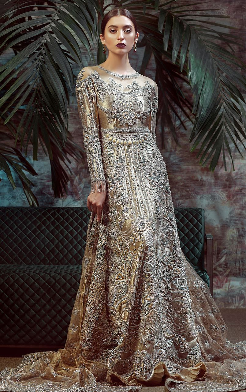 Champagne color beautiful heavily embroidered gown by pakistani