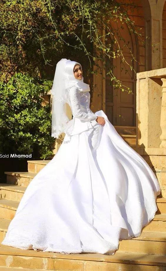صور فساتين زفاف للعروسة 2020 صور فساتين فرح باللون الأبيض 2021 فوتوجرافر Muslim Wedding Dresses Embellished Wedding Dress Wedding Dress Fabrics