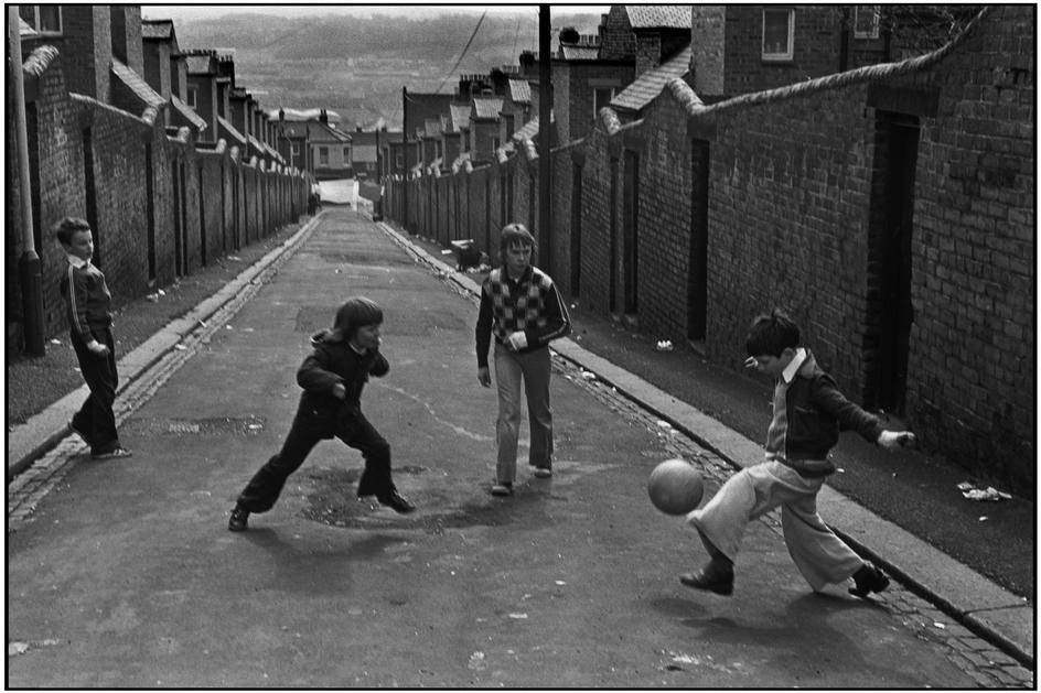 MARTINE FRANCK boys playing soccer in the street at  Newcastle-on-Tyne, UK (no date)