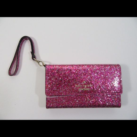 """Kate Spade Glitter Bug wristlet for iPhone 6 New Kate Spade Glitter Bug wristlet wallet for iPhone 6, new in box. The color is a glittery pink, interior is cream colored, it has a small mirror and a pocket for an iPhone 6. Made of faux leather. Comes with a detachable strap made of the same material.  Size: approximately 6.5"""" x 1.25"""" x 3.75"""".  Contact me if you have any questions.  Thank you! Kate Spade Bags Clutches & Wristlets"""