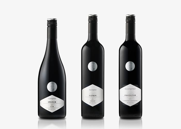 UXUS wine bottle packaging designs on Behance |Wine Bottle Graphic Design