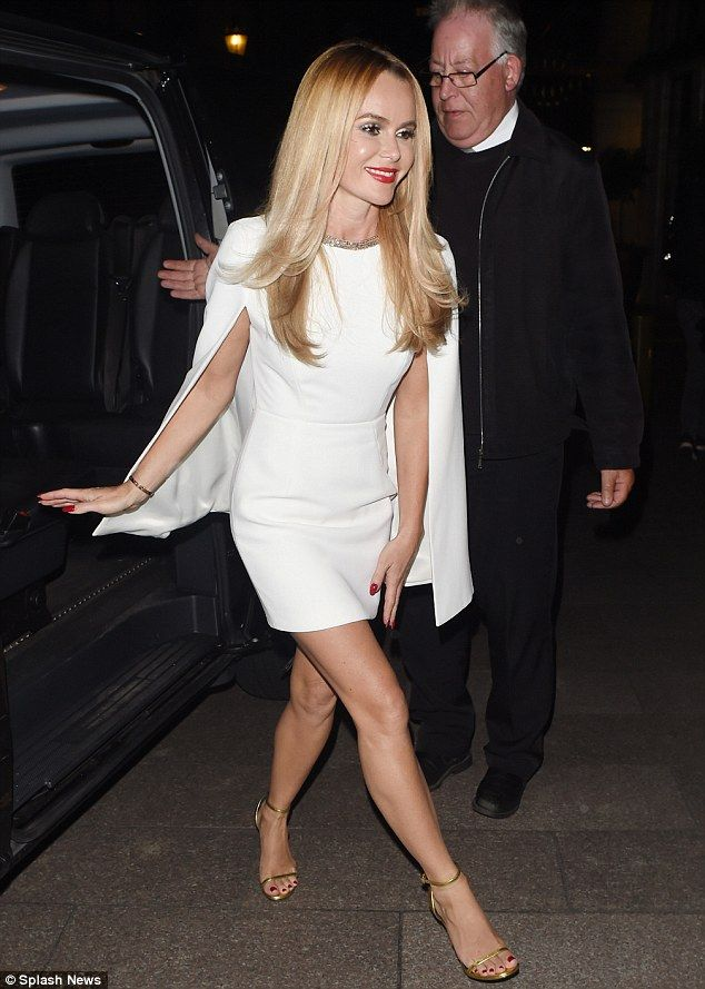 Make 3way:Standing tall in an envy-inducing pair of gold strappy heels, the BGT judge rou...