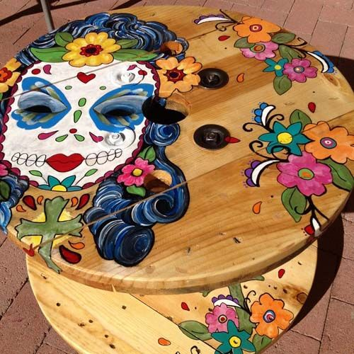 wooden cable spool table turned into painted girl face art diy project amazing garden ideas