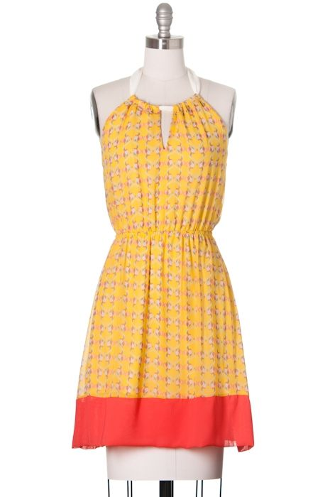 This lovely sundress has this season's trendy colors and a flirty adjustable halter neckline. The dress is fully lined but lightweight making it the perfect choice for a hot summer day.