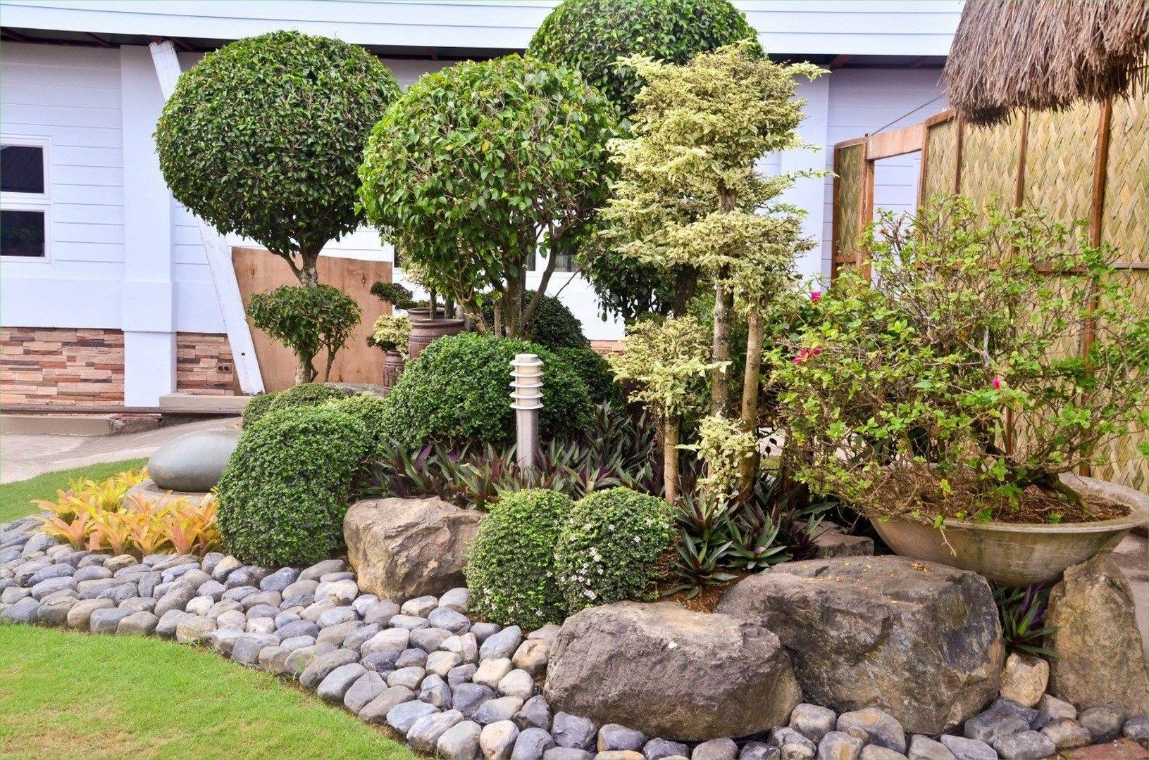 Mulch Improves The Appearance Of A Landscape In Several Ways Especially When Used To Its Entire Pote Landscaping With Rocks River Rock Garden Home Landscaping