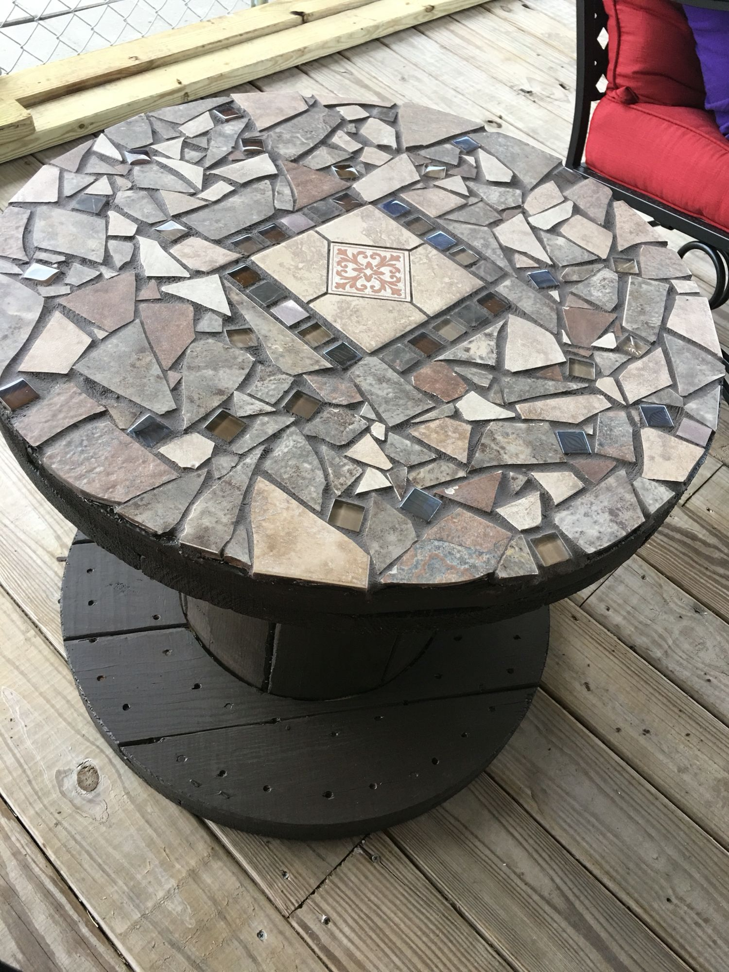 My table i made from a wooden spool and broken tiles for Large wooden spools used for tables