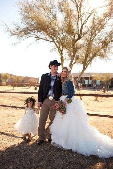 white wedding dress with denim jacket with ball gown silhouette