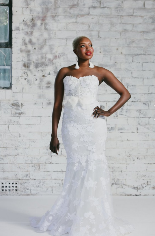 a341870ed36 This strapless wedding gown has an empire waist line. White strapless bridal  gown options from the Darius USA collection can be affordable.