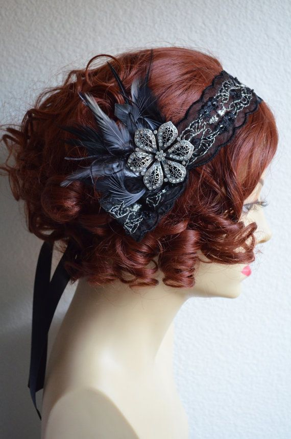 Detailed headband with brooch and feathers a 1920s bandeau style headpiece.