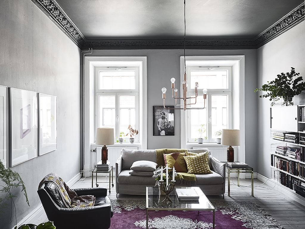Living room with grey walls, dark green ceiling and a purple rug ...