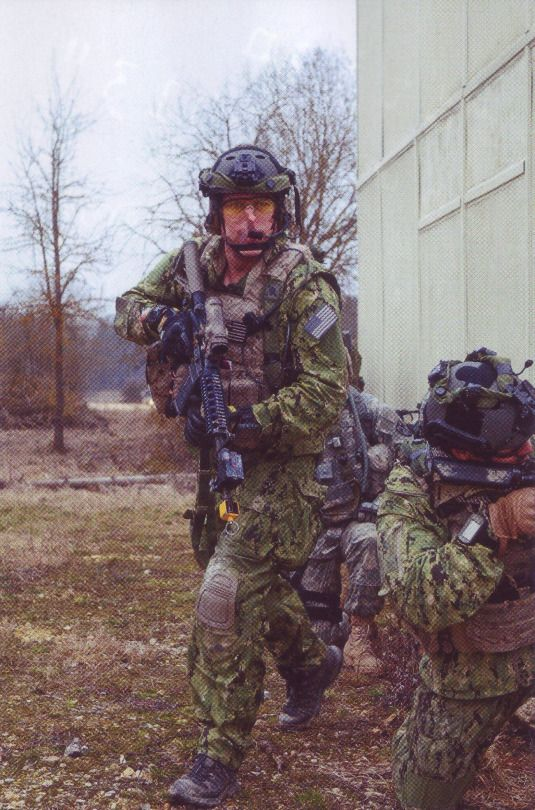 """Members with SEAL Team 1 participating in the mission rehearsal exercise """"Ash Hollow"""" at the Joint Multinational Readiness Center, Hohenfels, Germany. 2013"""