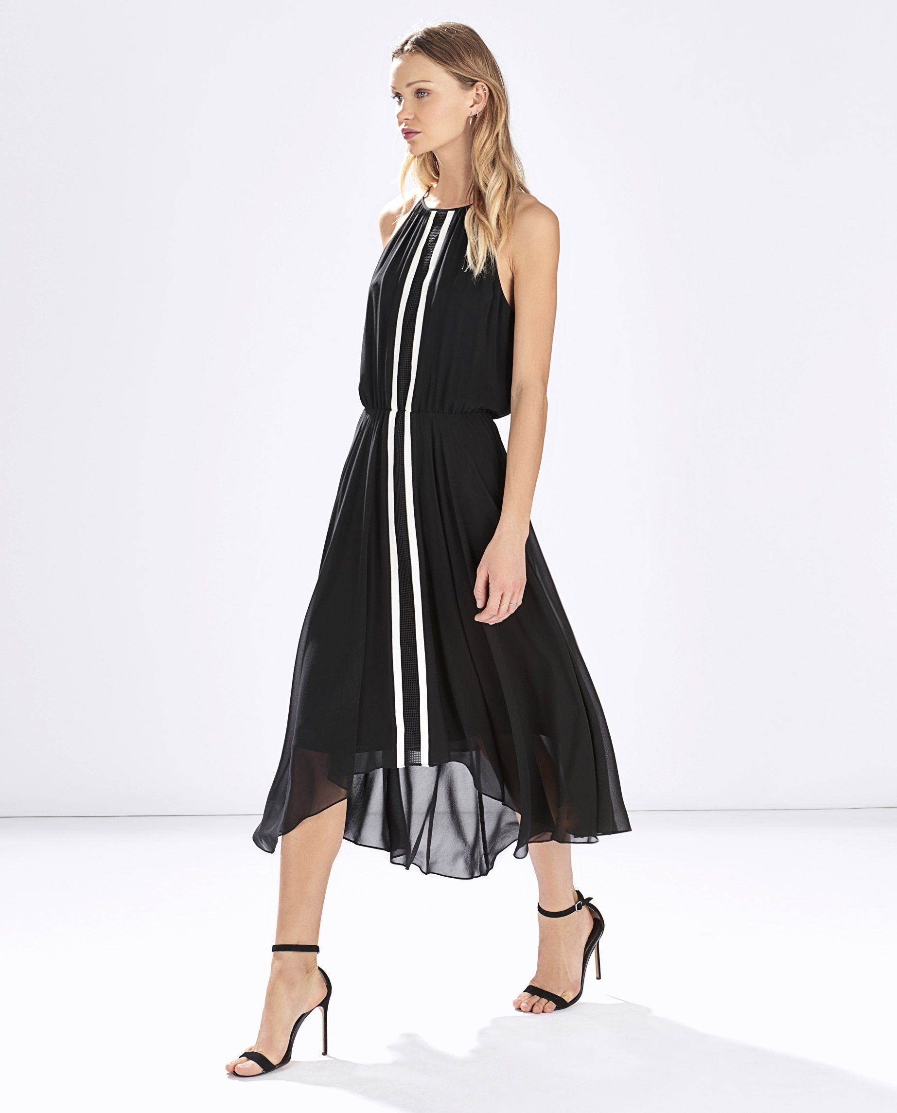 2818d317f4b6 Macedonia Dress. Beautiful flowy midi dress in black with white stripes.  Makes you look slim and tall.