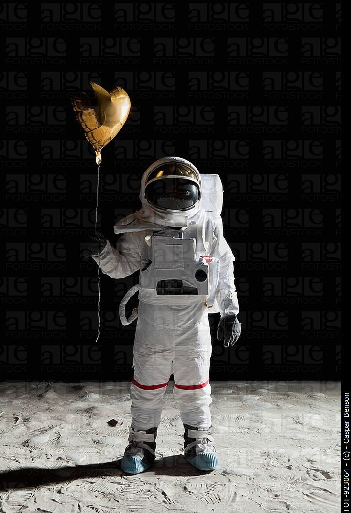 an astronaut in a space suit is motionless in outer space - photo #18