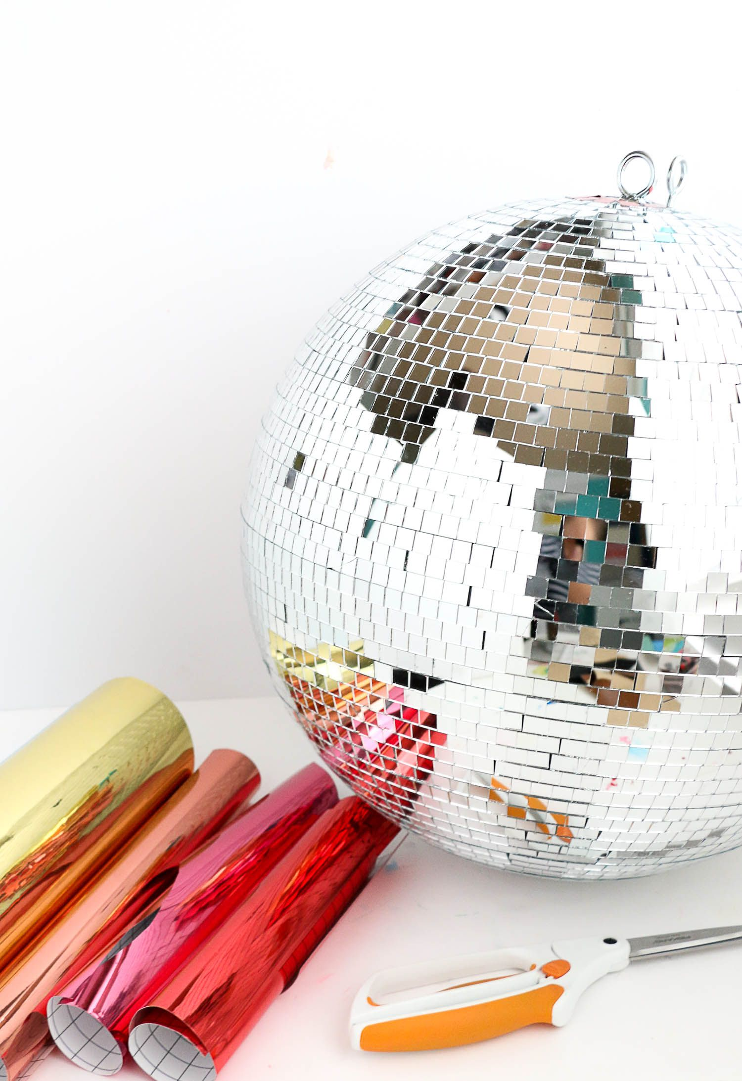Make Your Own Rainbow Disco Ball A Beautiful Mess Diy Disco Ball Disco Ball Paper Party Decorations