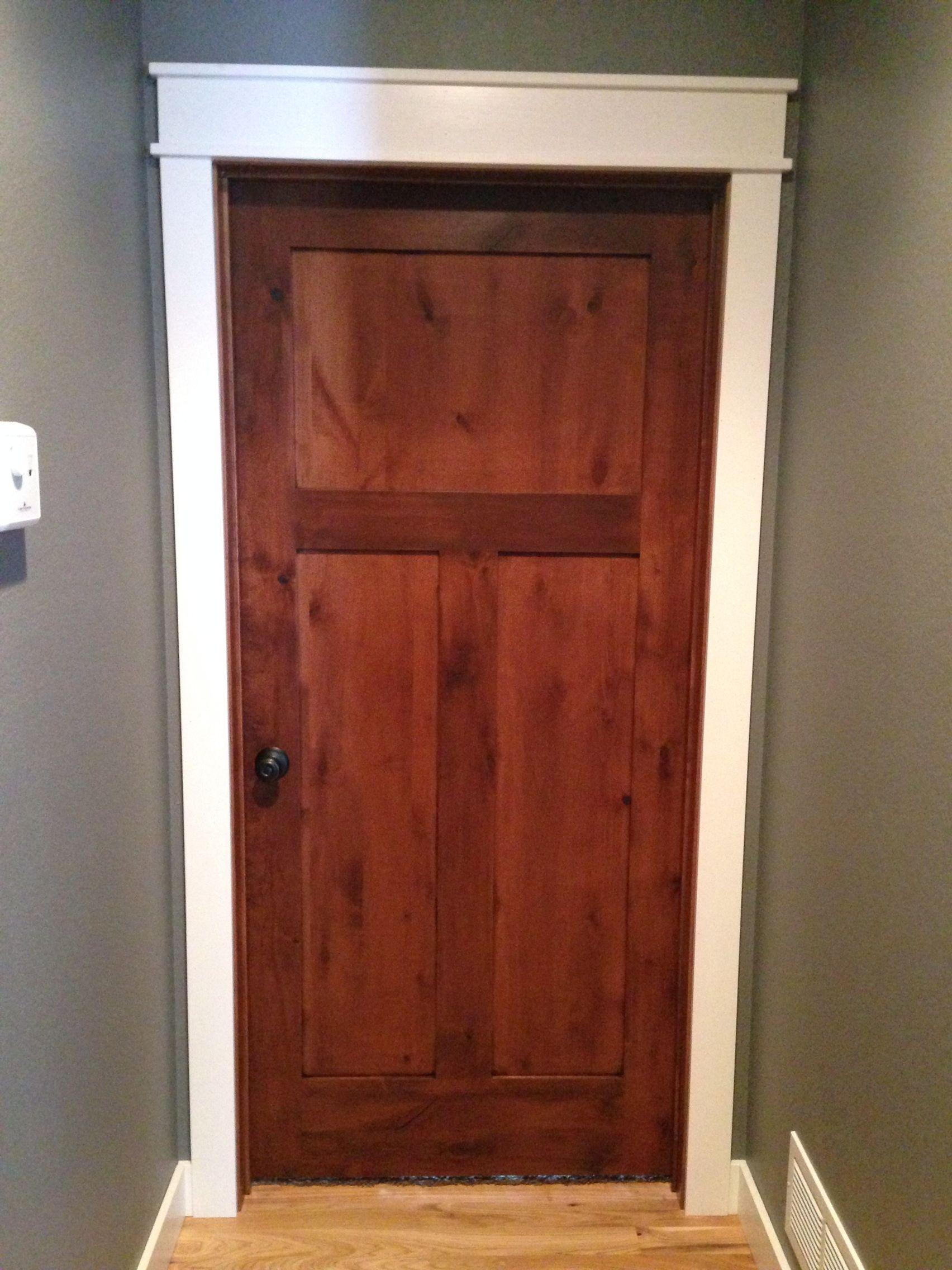 Rustic alder doors with white casings and trim Rustic