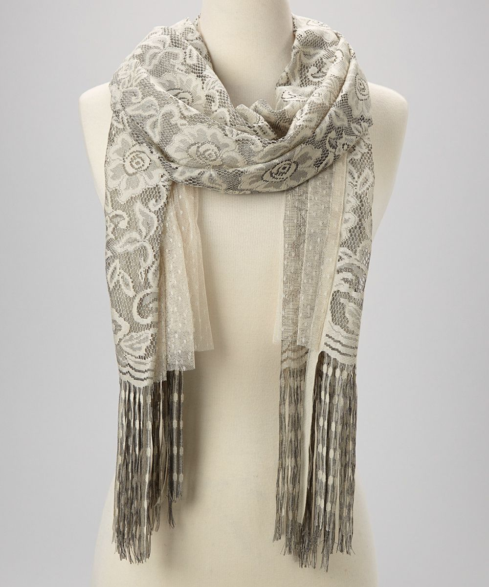 I love the colors of this scarf. This would look good with my silver hair.