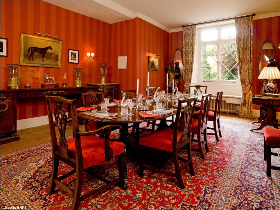 Grand: The Propertyu0027s Sumptuous Dining Room Is Decorated In Rich Red  Fabrics. It Is