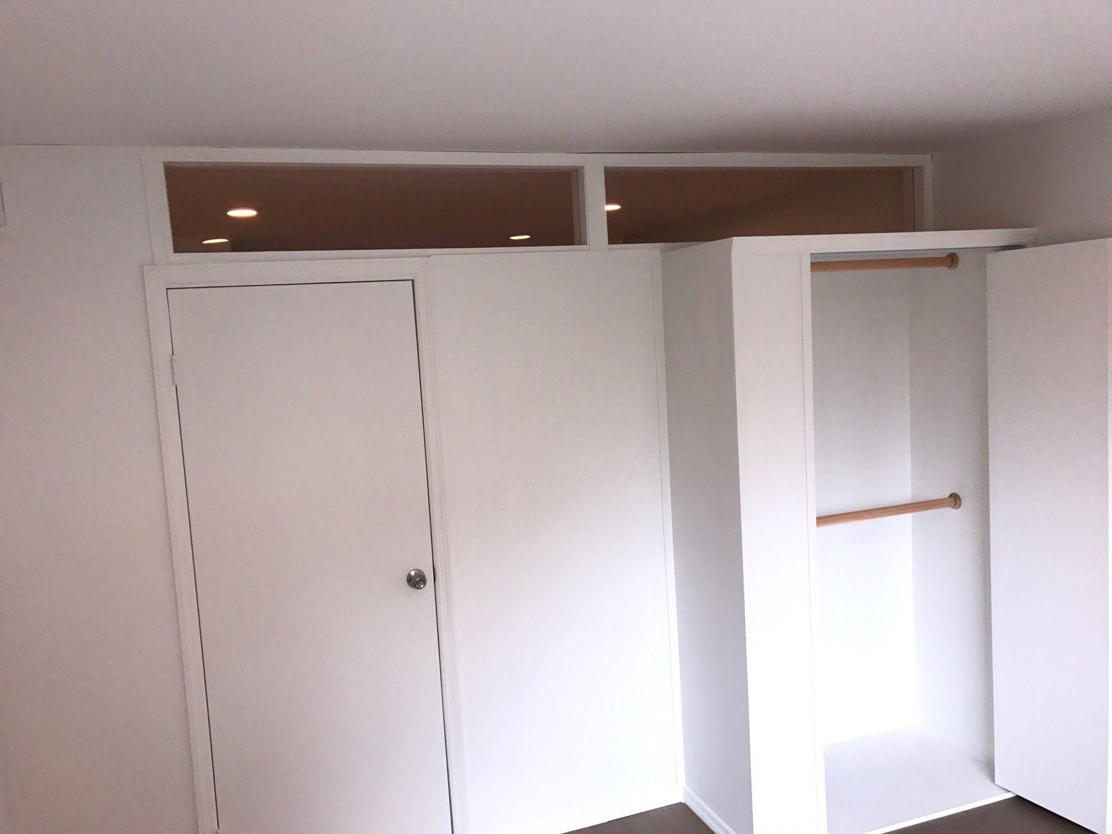 custom temporary wall with plexiglass transom and closet call us for all your custom room
