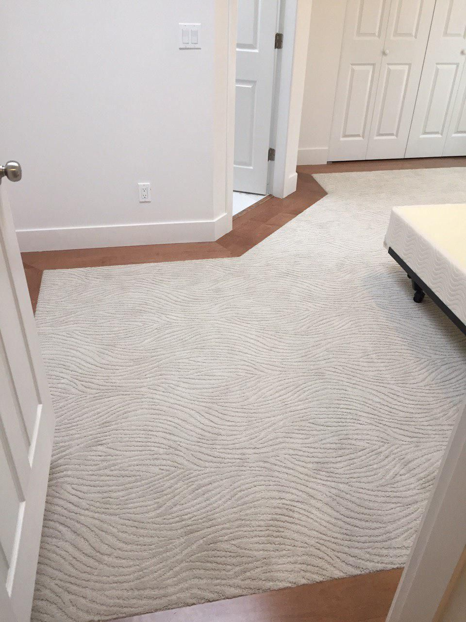 Mohawk Dramatic Flair in Hushed Beige carpet, maple hardwood floor border. Master bedroom renovation.